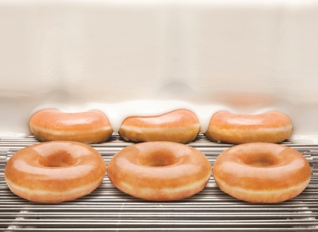 Get a dozen Krispy Kreme doughnuts for 80 cents on Friday