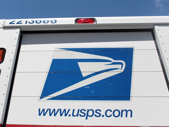 Mail Truck Crushes Car in Fatal Collision