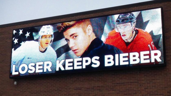 """Loser Keeps Bieber"": USA-Canada Rivalry Inspires Billboard"