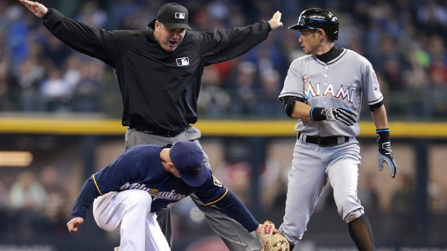 Brewers erupt early in rout of Marlins