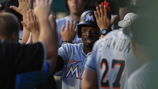 Conley strikes out seven, lifts Marlins past Reds, 7-3
