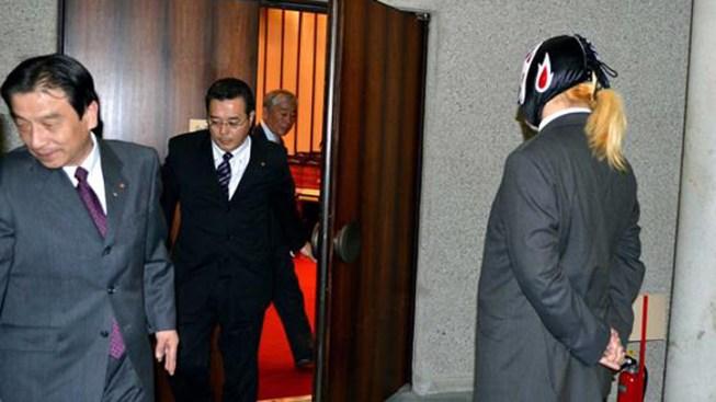 Japanese Wrestler-Turned-Politician Banned from Meetings for Mask