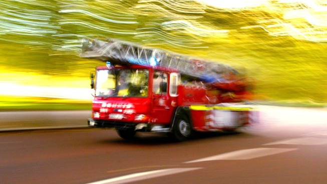 Man Rescued From Scooter Repair Shop Fire