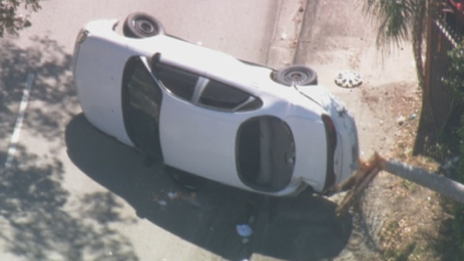 A teenage driver lost control of his car and flipped it on its side as he was being chased by police Thursday, police said. Witness Juan Sifontes described seeing the car upside-down.
