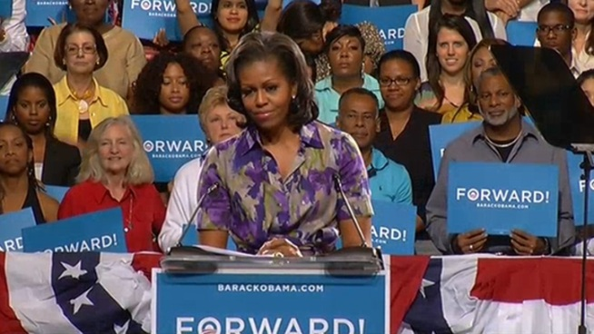 Stars Marc Anthony and Gabrielle Union attend a rally with Michelle Obama in Miami.