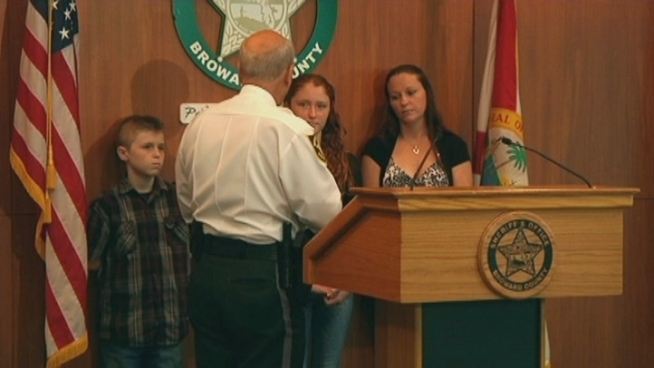 Alexis Stannis, 13, explained how she and her little brother Darren hid as three robbers tried to break in to their Pompano Beach home last week. BSO Sheriff Al Lamberti honored the two siblings on Monday. Darren, 10, shared some of his tips for warding off intruders.