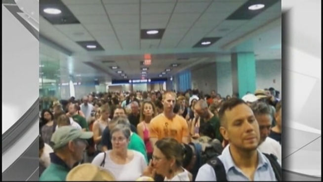 Frustrated passengers tried to keep their cool at Miami International Airport Monday morning after encountering unusual delays while trying to get through security. Passengers Andreas Duffner, David Abadine, Maria Fonseca and Steve Percifield comment.