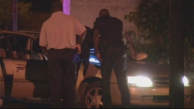 Three people were shot inside a car just before midnight in the area of Northwest 11th Avenue and 43rd Street, Miami Police spokeswoman Kenia Reyes said. The victim's girlfriend, Ashley Cambridge, and Cecil Deloach, who heard gunfire, spoke about the incident.