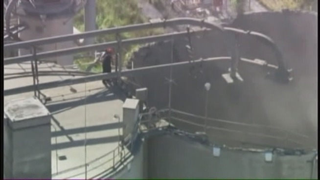 Rescuers were searching for the worker who fell about 140 feet after the roof of a silo collapsed at the Titan America cement plant in Medley Friday morning. Miami-Dade Fire Rescue spokesman Lt. Arnold Piedrahita explained how safety crews on the ground screamed out the man's name from the top of the silo, but did not hear from him. Crews examined the damage from the air and at one point came too close, sending up a cloud of debris.