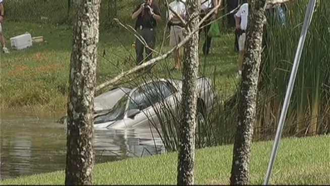 A dead man was found in a car that was discovered floating in a canal at 4100 Wiles Road Tuesday, police said. The man's identity has not been released.