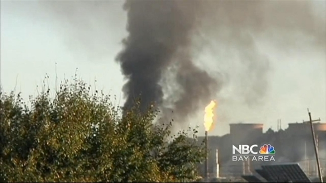 A controlled burn at the Chevron refinery in Richmond continued Tuesday morning, though the main blaze that ripped through the plant - and could be seen for miles - was put out late Monday night