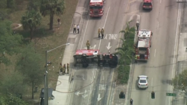 A Fort Lauderdale Fire Rescue unit that was transporting a patient to the hospital ended up overturned following a crash Wednesday morning, officials said.