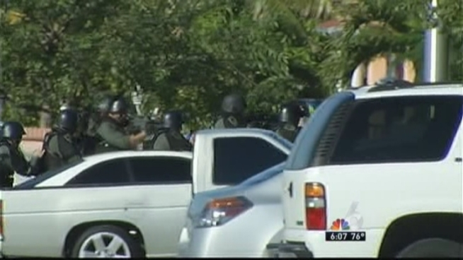 Hialeah police have apprehended a suspect they say allegedly barricaded himself inside a residence after shooting his family s dog.