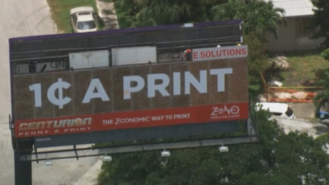 This billboard was put on Wednesday and is made up of 120,000 pennies.