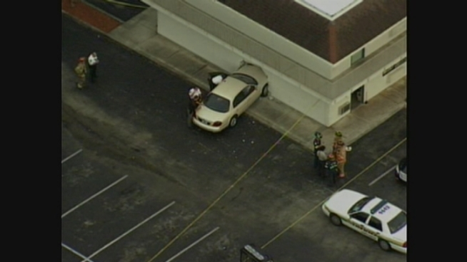 Authorities respond after a car crashes into a wall at a Dania Beach motel.