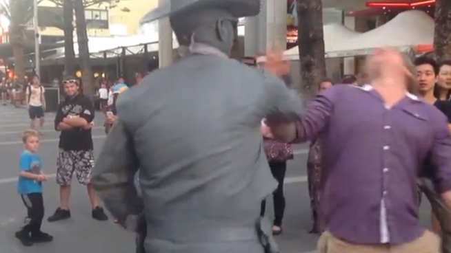 WATCH: Street Performer Punches Heckler